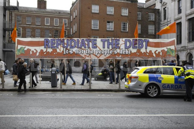 Marchers in Dublin, Ireland demand cancellation of bank debt that is destroying countries around the world.