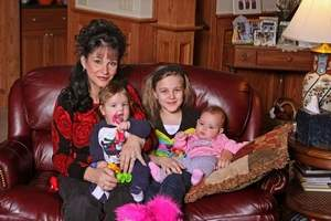 30th Circuit Judge Rosemarie Aquilina with 10-year-old daughter Johanna, 6-month olds twins Michael and Marissa; she has two older children in their late 20's