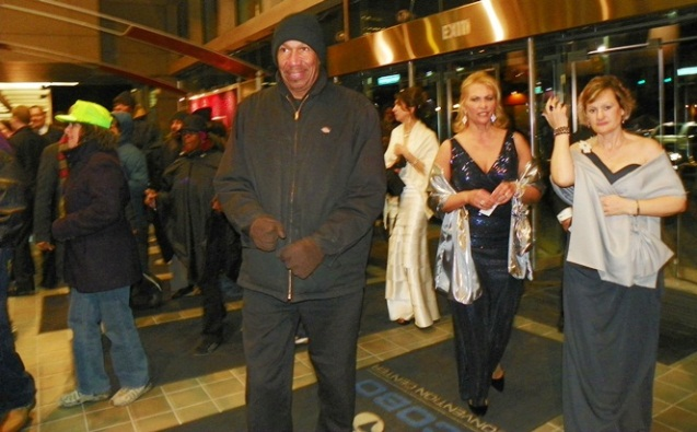 "Elite ""ladies"" appear shocked as workers and poor invade Auto Show with legal oberver (in green hat) Jan. 18, 2013."
