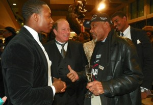 Mike Duggan, who wants to be Detroit's first white mayor since before Coleman Young, joshes with his lackeys at Auto Show Jan. 18, 2013.