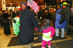 Father and child were among protesters who entered auto show Jan. 18, 2013.