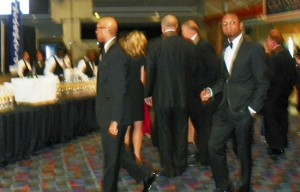City Council President Charles Pugh (l) shows up at Auto Show charity preview. He repeatedly ducked VOD camera afterwards.