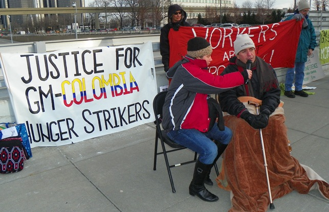 Jorge Parras (r), GM Colombian worker on hunger strike with 200 others after being fired for being injured on the job, outside the 2013 Detroit Auto Show at Cobo Hall.