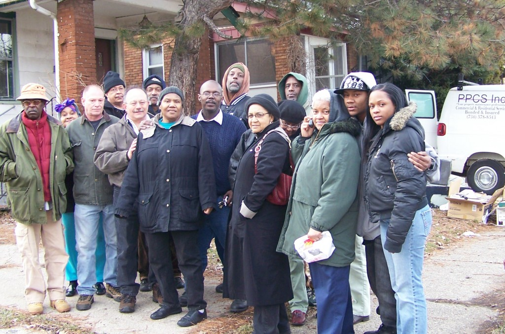 "Anthony King (center) lived in his home 41 years, caring for his parents before their deaths there. Members of Moratorium NOW!, other groups and his neighbors moved him back in March 11, 2009, but he eventually lost his home, as have millions of others across Detroit and the U.S. King is featured in Michael Moore's movie, 'Capitalism: A Love Story."" Photo by Diane Bukowski"