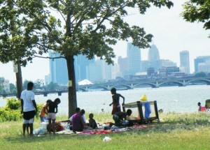 Family picnics near Belle Isle beach with view of downtown Detroit July, 2012.