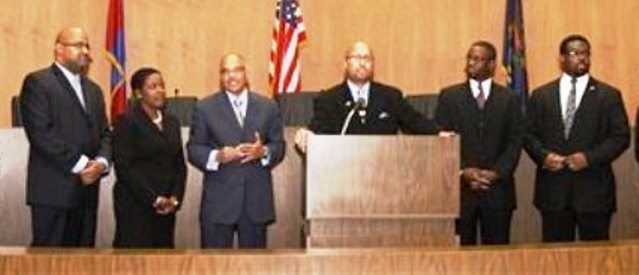Detroit City Council Sellout Six who voted to remove Crittendon: (l to r) Kenneth Cockrel, Jr., Saunteel Jenkins, Gary Brown, Charles Pugh, James Tate, Andre Spivey. They are shown taking their oaths of office after election.