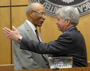 Michigan Gov. Rick Snyder hugs Mayor Dave Bing as he presents Damon Keith award to him Feb. 14
