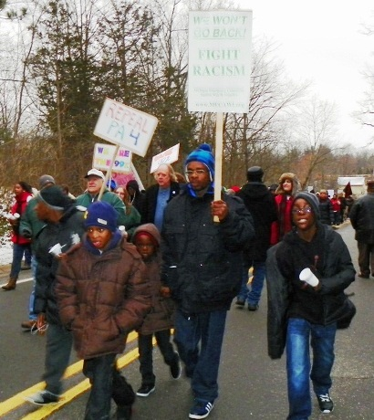 Marchers on Snyder's house demand a fight against racism, Jan. 16, 2012.