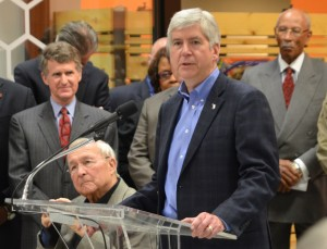 Gov. Snyder (center), shown with Detroit Mayor Dave Bing (l) and Oakland Co. Exec. L. Brooks Patterson, now dominates Detroit.