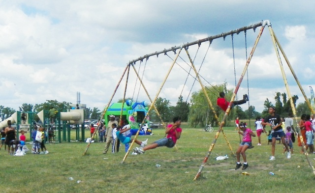 Detroit kids enjoy swings in Belle Isle Park, similar to those in many neighborhood  city parks Bing now wants to close.