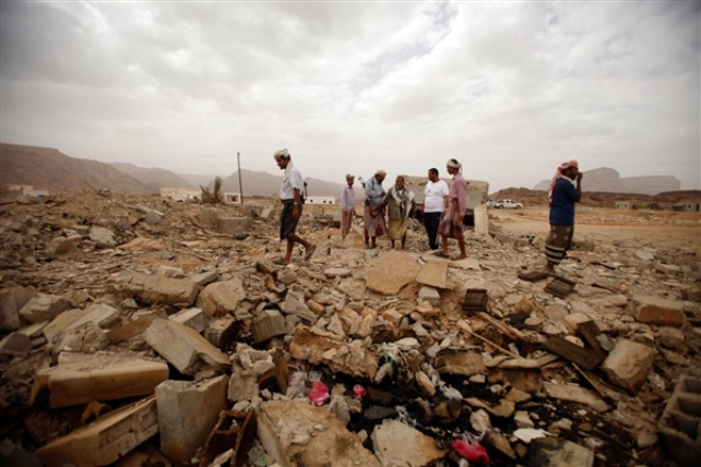 Tribesmen this week examine the rubble of a building in southeastern Yemen where American teenager Abdulrahmen al-Awlaki and six suspected al-Qaida militants were killed in a U.S. drone strike on Oct. 14, 2011. Al-Awlaki, 16, was the son of Anwar al-Awlaki, who died in a similar strike two weeks earlier. Khaled Abdullah / Reuters