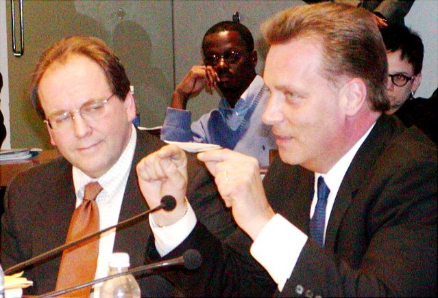 Stephen Murphy of Standard and Poor's (center l) and Joe O'Keefe of Fitch Ratings are shown at Detroit City Council Jan. 31, 2004 pushing a hotly contested $1.5 BILLION pension obligation certificate loan on Detroit, from UBS which just paid the USDOJ a $1.5 billion fine after admitting fraud, and its minority partner Siebert, Brandford and Shaw. The Council finally caved under threat of lay-offs and credit downgrades. Detroit defaulted on the debt twice, after the market crashed in 2008. To prevent bankruptcy, the city agreed to have its casino taxes and revenue-sharing funds funneled through the U.S. Bank of NA as trustee, to ensure debt payments.
