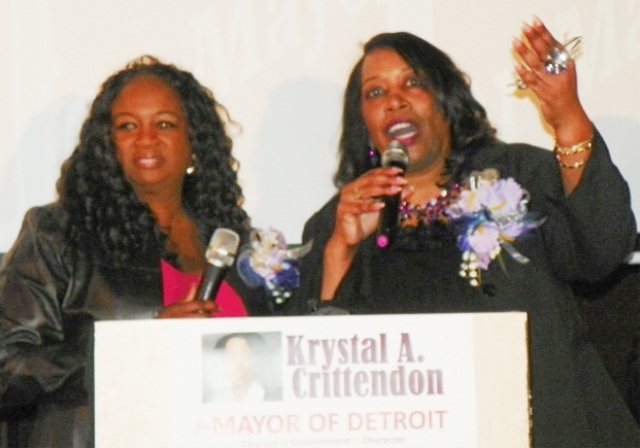 Krystal Jackson, co-chair of rally, joins mayoral candidate Krystal Crittendon on podium at end of rally Jan. 31, 2013, held at Bert's Place in Eastern Market.