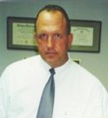 "Former Michigan parole board chair Stephen Marschke testified in 1999 regarding parolable lifers, ""It has been the longstanding philosophy of the Michigan Parole Board that a life sentence means just that–life in prison . . . Good behavior is expected and is not in and of itself grounds for parole."" As Berrien County Sheriff in 1994, he was the last person to see Black teenager Eric McGinnis, 16, alive before the child's body was found in the St. Joseph River which separates the white town of St. Joseph from nearly all-Black Benton Harbor."