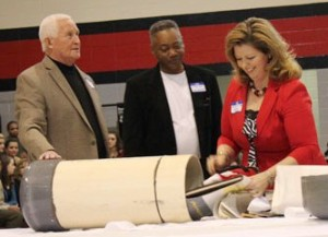 Bobby Harris (center) was previously assistant principal of Thompson High School in Alabaster, AL. He is shown here with others opening school time capsule.