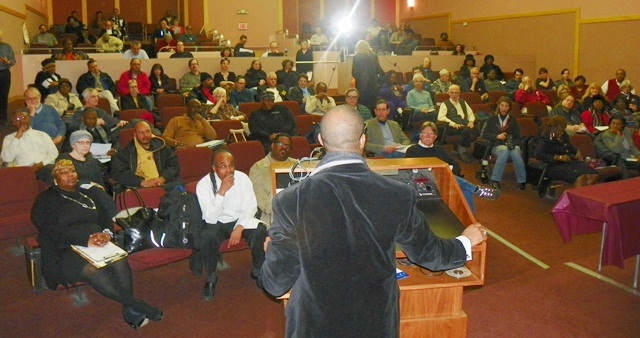 Rev. David Bullock addresses crowd at Kick-Off Rally to Stop Government Foreclosures of Our Homes, Feb. 13, 2013.