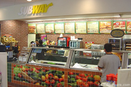 Subway workers in Detroit said they fell off fiscal cliff in their 2013 paychecks, while Subway went up on its prices.