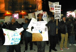 Autoworkers and supporters picket Detroit auto show Jan. 13, 2013.