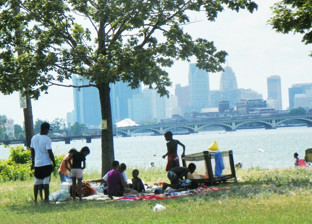 Family picnics on Belle Isle with gorgeous view of downtown Detroit. BELLE ISLE IS BLACK LAND AS IS DETROIT!