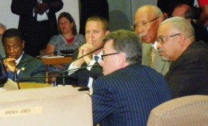 """Mike"" McGee (back to camera) advises Bing et. al. on the consent agreement."