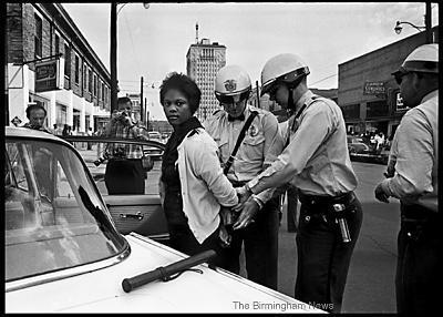 May 7, 1963: Birmingham Police arrest Parker High School student Mattie Howard in front of the Carver Theatre. Youths became an integral part of the civlil rights movement when the Children's Crusade began on May 2. The plan was for college and high school students to demonstrate, but many came with their younger brothers and sisters. Howard's arrest came during Day 6 of the Children's campaign. Photos of her arrest appeared in several publications outside of Alabama. (Norman Dean, Birmingham News file)