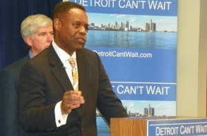Kevyn Orr with his white shadow Gov. Rick Snyder at March 14 press conference.