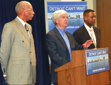 Michigan Gov. Rick Snyder, flanked by Detroit Mayor Dave Bing (l) and new EFM Kevyn Orr (r), announces state takeover of Detroit.