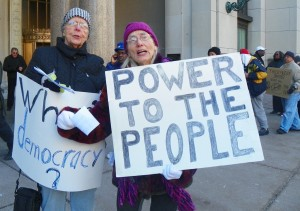 Two of the many demonstrators who picketed the EM press conference March 14, 2013.
