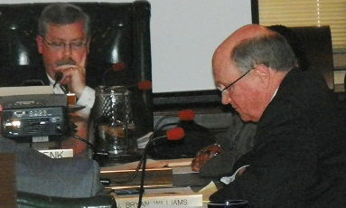 BOWC chair James Fausone and Oakland Co. rep. J. Bryant Williams appear to be deeply studying RCC report at meeting March 13, 2013. They couldn't have studied TOO hard, as blatant falsehoods were rampant in report..