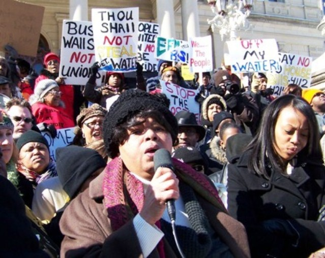 Sandra Hines speaks at Feb. 2011 rally in Lansing against takeovers.