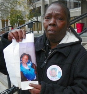 Aiyana's grandmother Mertilla Jones weeps as she shows the child's photo after earlier hearing Oct. 29, 2012.