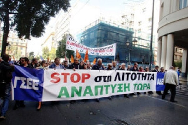"General strike in Greece against austerity including ""debt-restructuring"" IMF policies. Banner reads: Stop Austerity, Growth Now. Greeks protested is every major city."