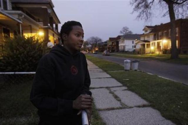 Much of Detroit's streets look like this one in Highland Park, which shows Cassandra Cabil at her home after Highland Park cut a deal with DTE to remove half the city's street lights. Under a new Public Lighting Authority, 40 percent of Detroit's street lights, many already gone, will also be permanently removed. The blame lies with Wall Street.