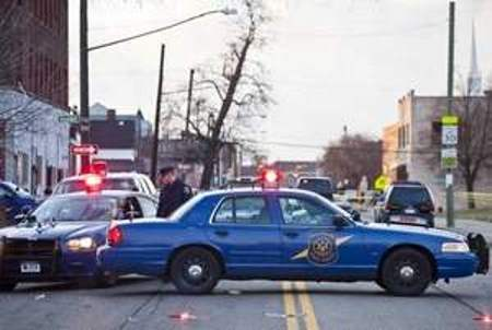 """Detroit and state police cars at Linwood and Hooker April 2 after officers shot 23-year-old Matthew Joseph to death under suspicious circumstances. Media reports indicated """"friendly fire"""" was involved in the shooting of one cop, and that Joseph was being pursued as a suspect in the killing of another cop's drug-dealer son. Neighbors say at least 20 poice cars came to the area, that there were three people in the car who remained motionless for the two hours they watched them. The driver Matthew Joseph was slumped over the steering wheel and did not appear to have exited the car. VOD is investigating further."""