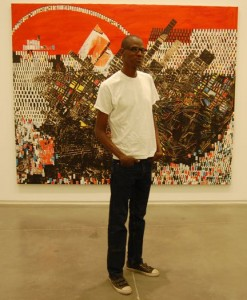 "Artist Mark Bradford with his mural, ""Scorched Earth."""