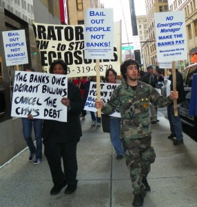 Protesters in downtown Detroit demand cancellation of Detroit's debt to banks.