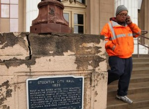 Stockton, CA city worker leaves city hall in Feb. 2013.