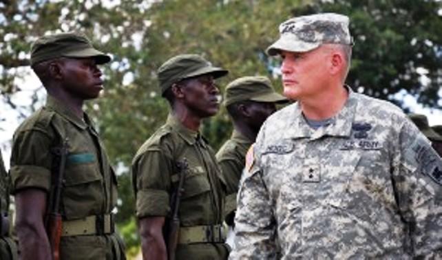 US Major General David Hogg inspects Ugandan troops. Photo Ryan Sutherland