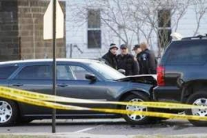 Close-up of Matthew Joseph's car after his body was removed, shows window shot out.