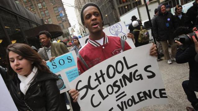 Chicago students march through the Loop protesting the city's plan to close more than 50 elementary schools on March 25, 2013 in Chicago, Illinois. Last week the city announced the plan claiming it was necessary to rein in a looming $1 billion budget deficit. The closings would shift about 30,000 students to new schools and leave more than 1,000 teachers with uncertain futures. (Photo by Scott Olson/Getty Images)