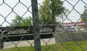 Cadillac and Quicken Loans on fenced-off race course.