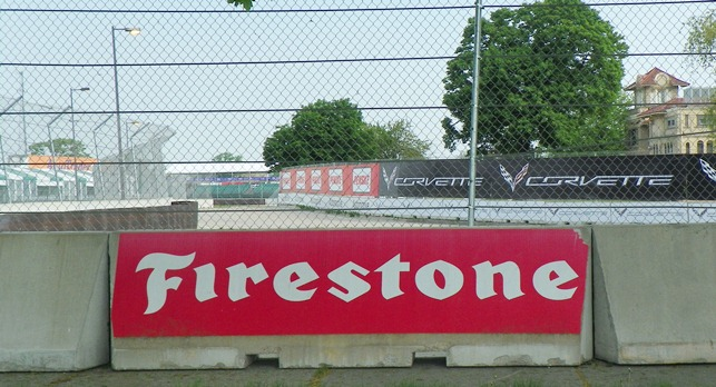 Firestone and Corvette signs adorn the barricades at the 2013 DBIGP.