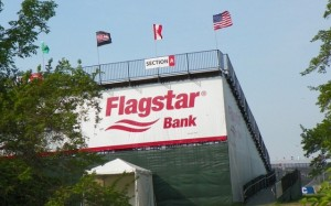 Flagstar Bank, one of many banks and corporations sponsoring the Detroit Belle Isle Grand Prix. Flagstar put Jennifer Britt among thousand of others out of their homes, and was featured in protest signs at the May 4 rally for a moratorium on Detroit's debt to the banks.