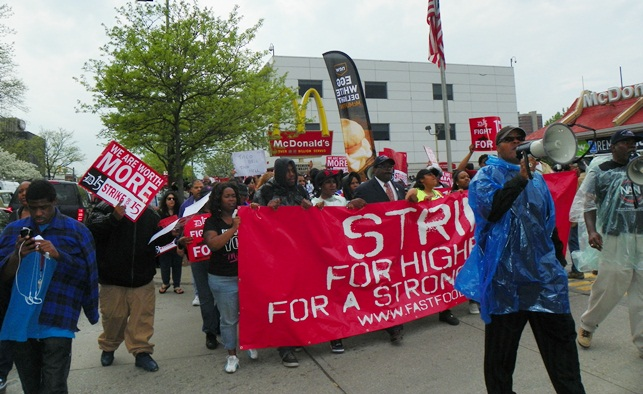 Pastor Charles Williams II leads march as it takes off outside New Center McDonald's May 10, 2013.