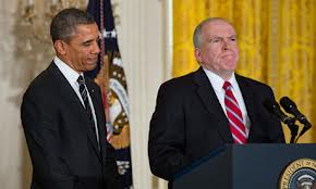 President Barack Obama and CIA director John Brennan at his swearing in.