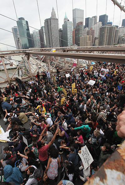 OCCUPY WALL STREET PROTESTERS BLOCK THE BROOKLYN BRIDGE IN NEW YORK CITY IN 2011.