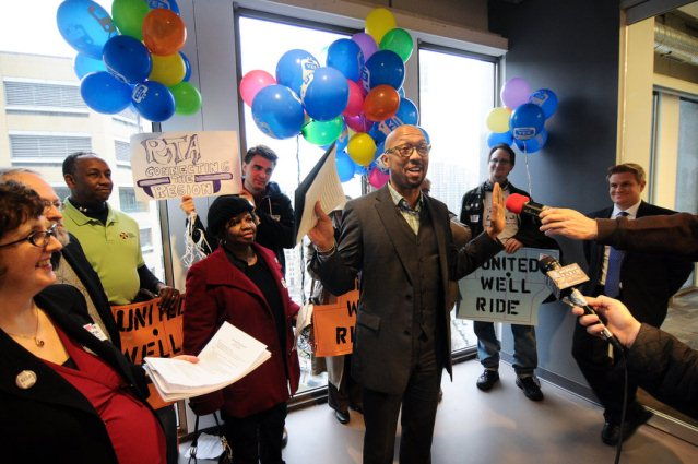 Detroit City Council President Charles Pugh addresses the RTA supporters crowd in the Southeast Michigan Council of Governments (SEMCOG) office in 1001 Woodward. Transportation Riders United and regional transit supporters held a march, from Rosa Park Transit Center to the SEMCOG offices in 1001 Woodward, and birthday party including balloons and cake for the first meeting of the Regional Transit Authority with its county representatives. (Tanya Moutzalias | MLive.com)  Now the City Council and Detroit's Mayor Dave Bing want to sue to stop reduction in D-D-DOT funding, but EM Kevyn Orr is not in favor of doing so.