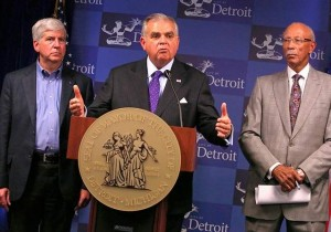 Michigan Gov. Rick Snyder, U.S. Transportation Secretary Ray LaHood, and Mayor Dave Bing in Detroit Oct. 12, 2012.