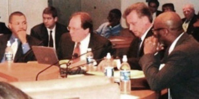Joe O'Keefe of Fitch Ratings and Stephen Murphy of Standard and Poor's (center) at City Council table Jan. 2005, Also present, KIlpatrick's CFO Sean Werdlow (l) and Deputy Mayor Anthony Adams (r). Photo by Diane Bukowski