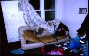Evidence photo shows couch where Weekley shot Aiyana in the head. Hannah Montana blanket is at bottom of photo.